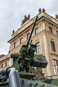 Detail of cannon tube (machine gun) and armored military vehicle in Prague - stock photo