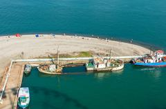 Sunken shipwreck on the coast in port of Georgia Stock Photos
