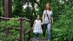 Asian mother and daughter walking together in the park, Slow motion Stock Footage