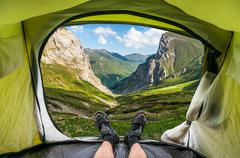 View from inside a tent on the beautiful grassy valley in the Macedonian moun - stock photo