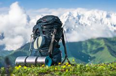 Tourist backpack and sleeping pad on a background of mountains, Georgia (Svan Stock Photos