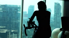 Stock Video Footage of Young woman riding stationary bike in gym, super slow motion 120fps