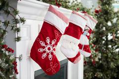 Empty Stockings Hung On Fireplace On Christmas Eve Stock Photos