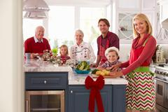 Family With Grandparents Preparing Christmas Meal In Kitchen Stock Photos