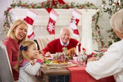 Family With Grandparents Enjoying Christmas Meal At Table Stock Photos