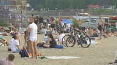 People sitting at Plaza Miejska, next to Poniatowski Bridge, Warsaw Stock Footage