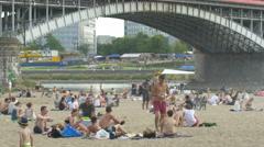 Relaxing at Plaza Miejska, next to Poniatowski Bridge in Warsaw Stock Footage