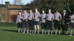 Eton Wall Game St Andrews Day 2015. Pan across Collegers team pre-match wide Stock Footage