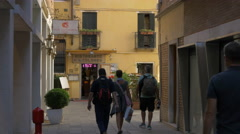Tourists walking in Corte Teatro, Venice Stock Footage