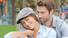 Portrait of in love young couple in town - stock footage
