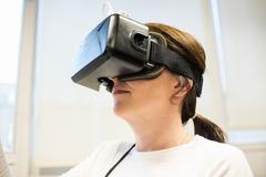 Businesswoman using oculus rift headset Kuvituskuvat