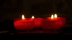 Little red candles in a church Stock Footage