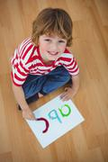 Boy painting an abc on some paper Stock Photos