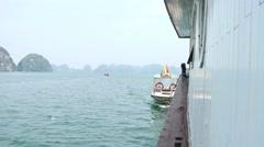 4k ha long bay vietnam old traditional wood boat paradise tropical holidays Stock Footage