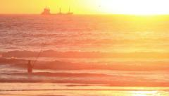 The fisherman, sunset, sea, sun Morocco cargo ship in background Stock Footage