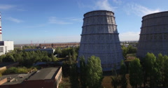 Aerial shot over old to new water cooling tower vertical angle - stock footage