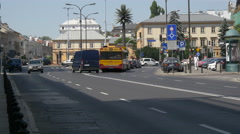 Driving cars and buses on Nowy Swiat, near the faimous palm tree of Warsaw Stock Footage