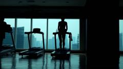 Young woman walking on treadmill in gym, super slow motion 120fps Stock Footage