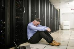 Technician feeling the pressure in server room Stock Photos