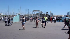 People on the bridge, front of Mare Magnum, Barcelona Stock Footage