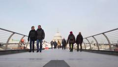 LONDON, UK  People on Millennium Bridge - stock footage