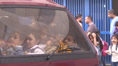 Syrian refugee children in a car in Lebanon Stock Footage