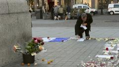 Man posting messages around monument - French city after attacks Stock Footage
