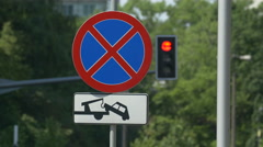 No stopping and parking sign and a traffic light on a street in Warsaw Stock Footage