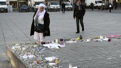 Arab woman reading messages around monument - French city after attacks Stock Footage