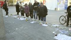 People reading messages around monument - French city after attacks Stock Footage