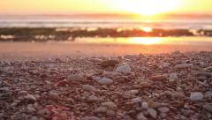 see shore of Morocco. Camera pan over Atlantic Ocean from sandy/stony beach - stock footage