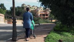 Young mother walking with perambulator in the small city HD Stock Footage