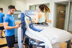 Stock Photo of Woman using an anti gravity treadmill
