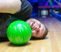 Drunk man on bowling alley Stock Photos