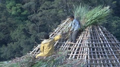 Stock Video Footage of Huli wigmen roof construction 6