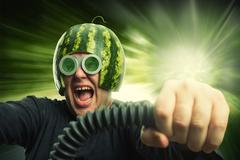 Bizarre man in a helmet from a watermelon - stock photo