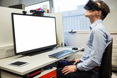 Businessman using oculus rift headset Kuvituskuvat