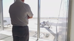 Passenger looking out the window of the plane Stock Footage