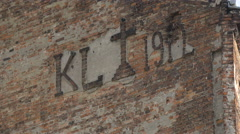 Inscriptions on the old brick wall of a building on Sprzeczna street, Warsaw Stock Footage