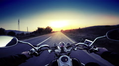 A motorcycle road adventure going forward to the sun in high speed. pov at su Stock Footage