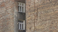 Old brick building on a street in Warsaw Stock Footage