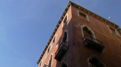 The corner of a building with Venetian arches in Venice - stock footage