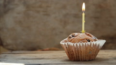 Tasty birthday cupcake with candle Stock Footage