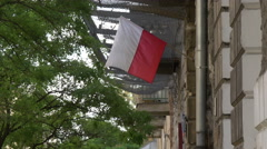Flag of Poland on a building in Warsaw Stock Footage