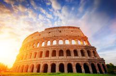 Colosseum in Rome, Italy. Amphitheatre in sunrise light. Stock Photos
