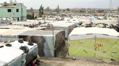Tents in a Syrian refugee camp in Lebanon Stock Footage