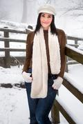 Woman wearing knitwear enjoying snow Stock Photos