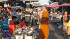 Monk collecting alms at market,Surin,Thailand Stock Footage