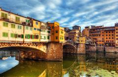 Ponte Vecchio bridge in Florence, Italy. Arno River. Stock Photos