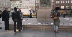 Tilt-down from monument to people reading messages around monument - French city Stock Footage